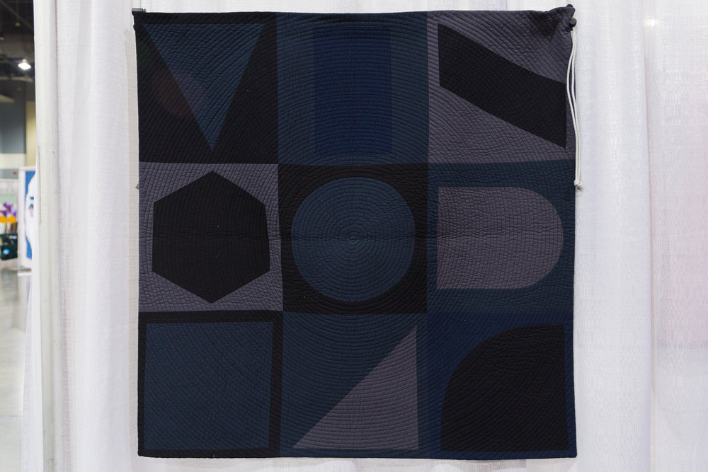 """3rd Place: Dark Geometry  33"""" x 33"""" Pieced and quilted by Susan McKinney Waltham, MA, United States Boston Modern Quilt Guild"""