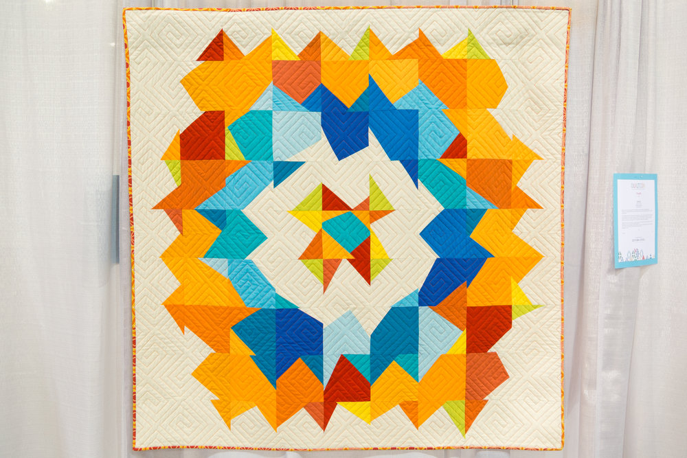 """3rd Place: Supernova  52.5"""" x 52.5"""" Pieced by Aida Gates Pieced with Aida's grandmother Judy Moyer Quilted by Laura Simmons of Pieceful Quilts Binding by Aida's mother, Julie Moyer Parker, Colorado, United States Individual MQG Member"""