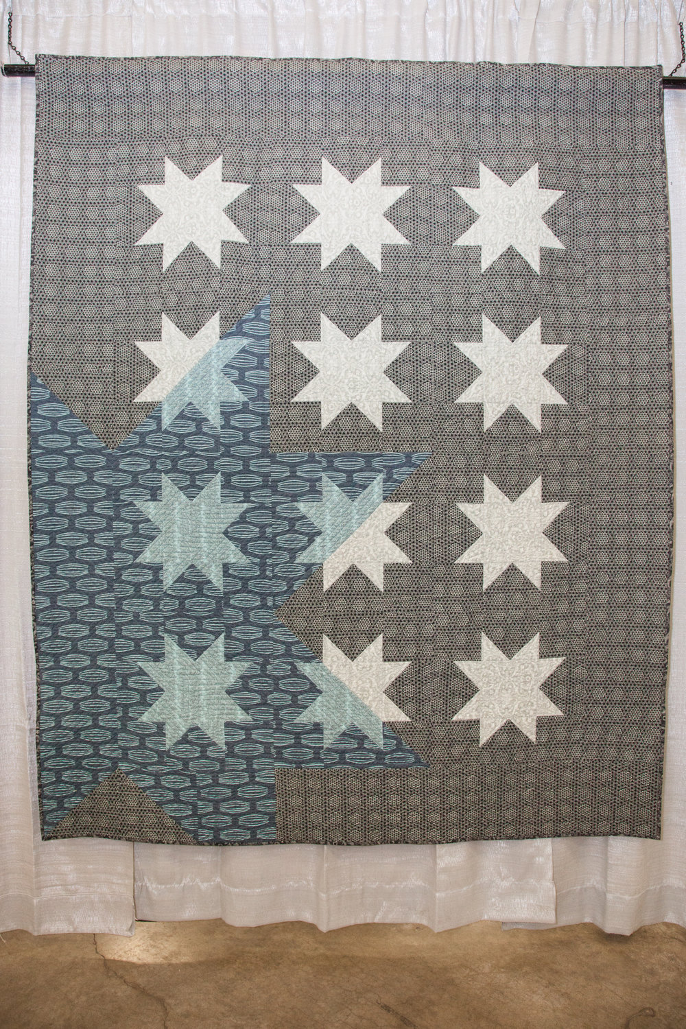 1st Place: New Star Rising  Pieced and quilted by Ben Darby