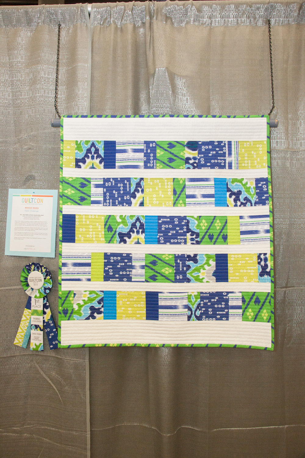 1st Place: Dear Stella as Charm Squares Baby Quilt  Pieced and quilted by Melody Baker