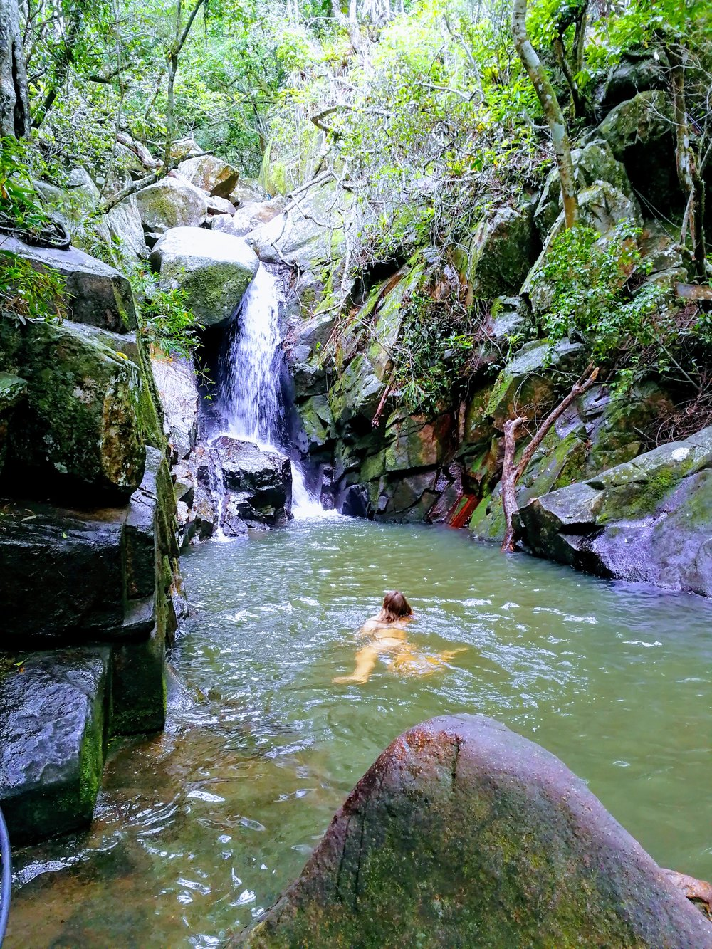 Swimming in the pool beneath Cachoeira da Solidão in Florianopolis, Brazil.