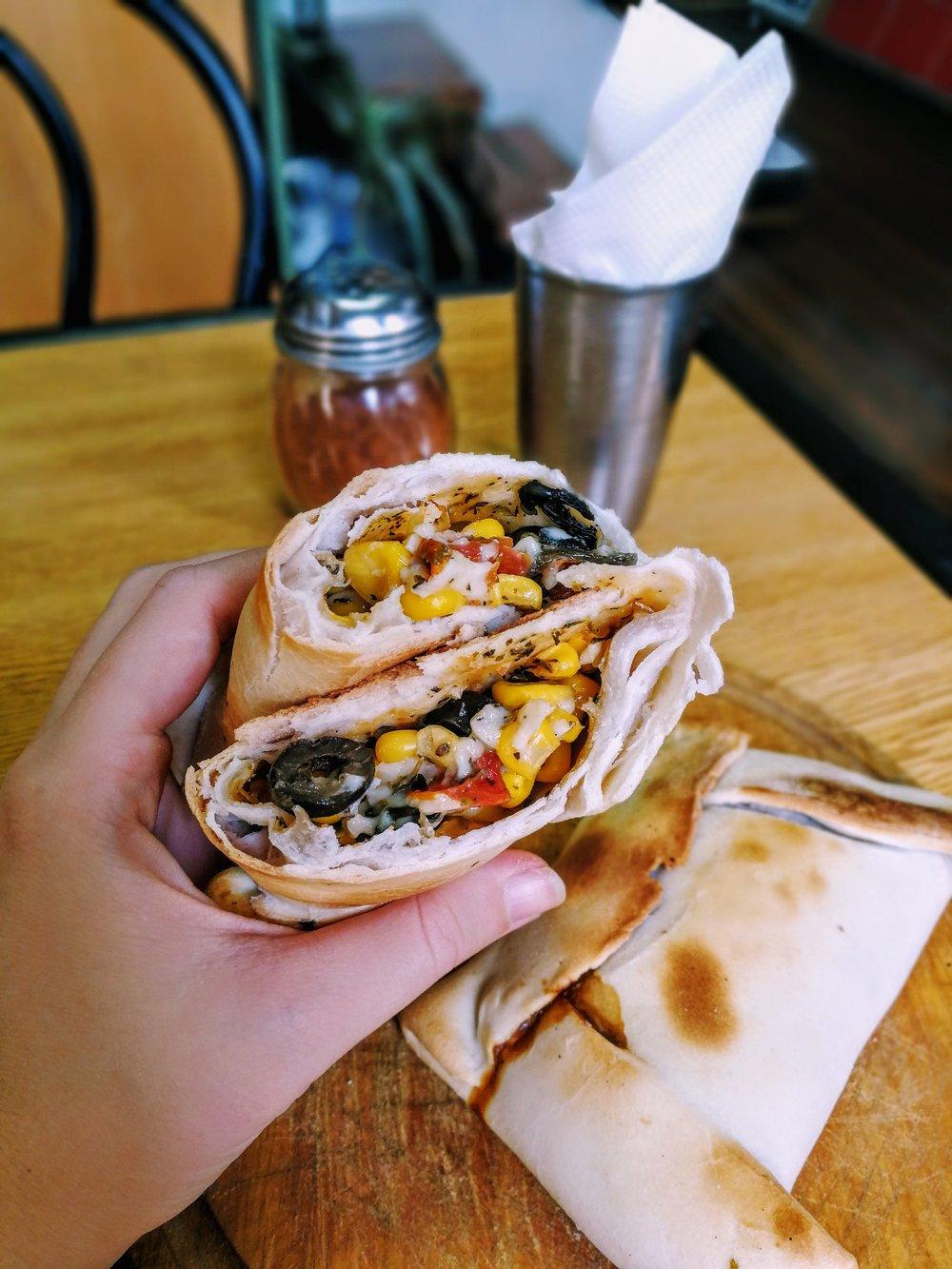 A classic  Humita  empanada stuffed with fresh corn, black olives, vegan mozzarella, and fresh basil at Café Vegan El Tribus (#2)