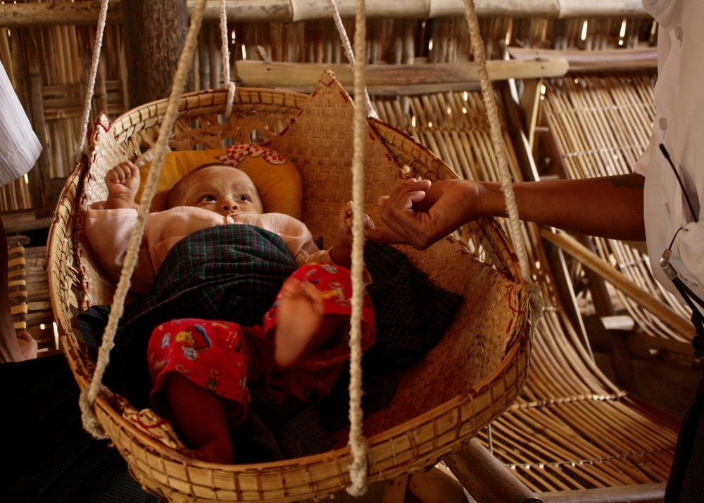Baby in a Basket. Parenthood is a beautiful thing. Travel photos from across Myanmar.