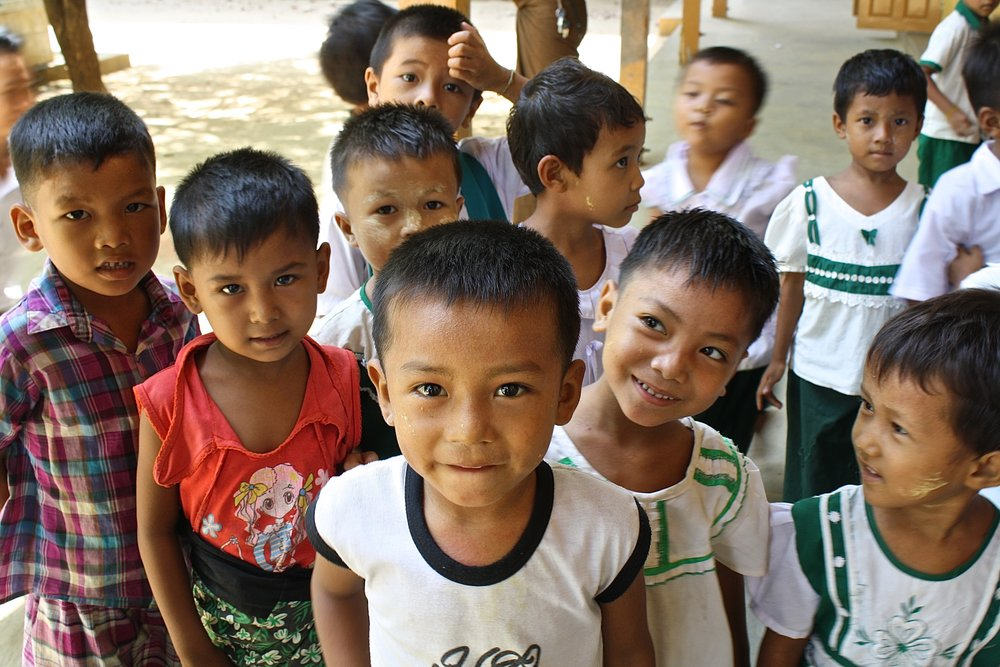 Students in Myanmar on recess. Build a School in Burma.