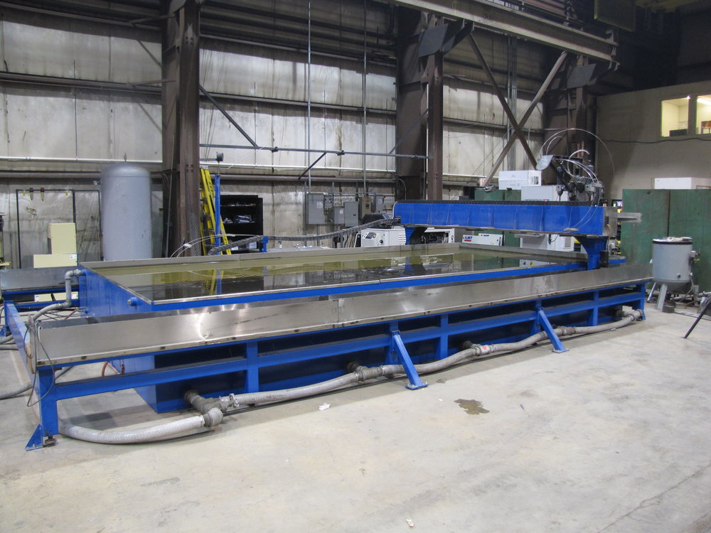 "Ohio Steel's newest addition to our burning capabilities is a Romeo CNC Waterjet machine. The x-axis travel 245.488"" and y-axis travel is 112.625. The KMT Streamline water intensifier operates at 60,000 psi with single or dual heads cutting from 3"" to 61"" inches apart. Any material can be cut up to 6"" thick. The abrasive garnet mixed with high pressure water allows for clean burning on harder materials, cutting down on cleaning, grinding, and prep time for your raw materials."