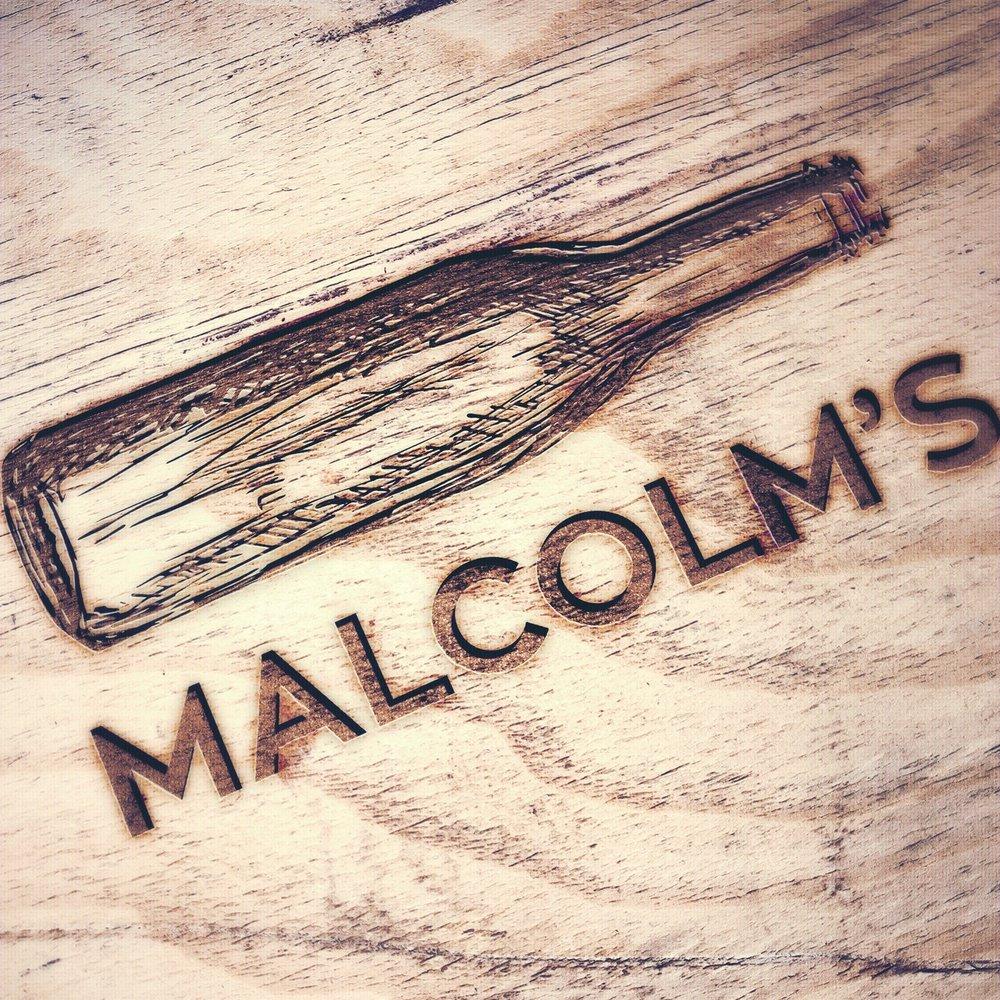 Malcolms_WoodMockup.jpg