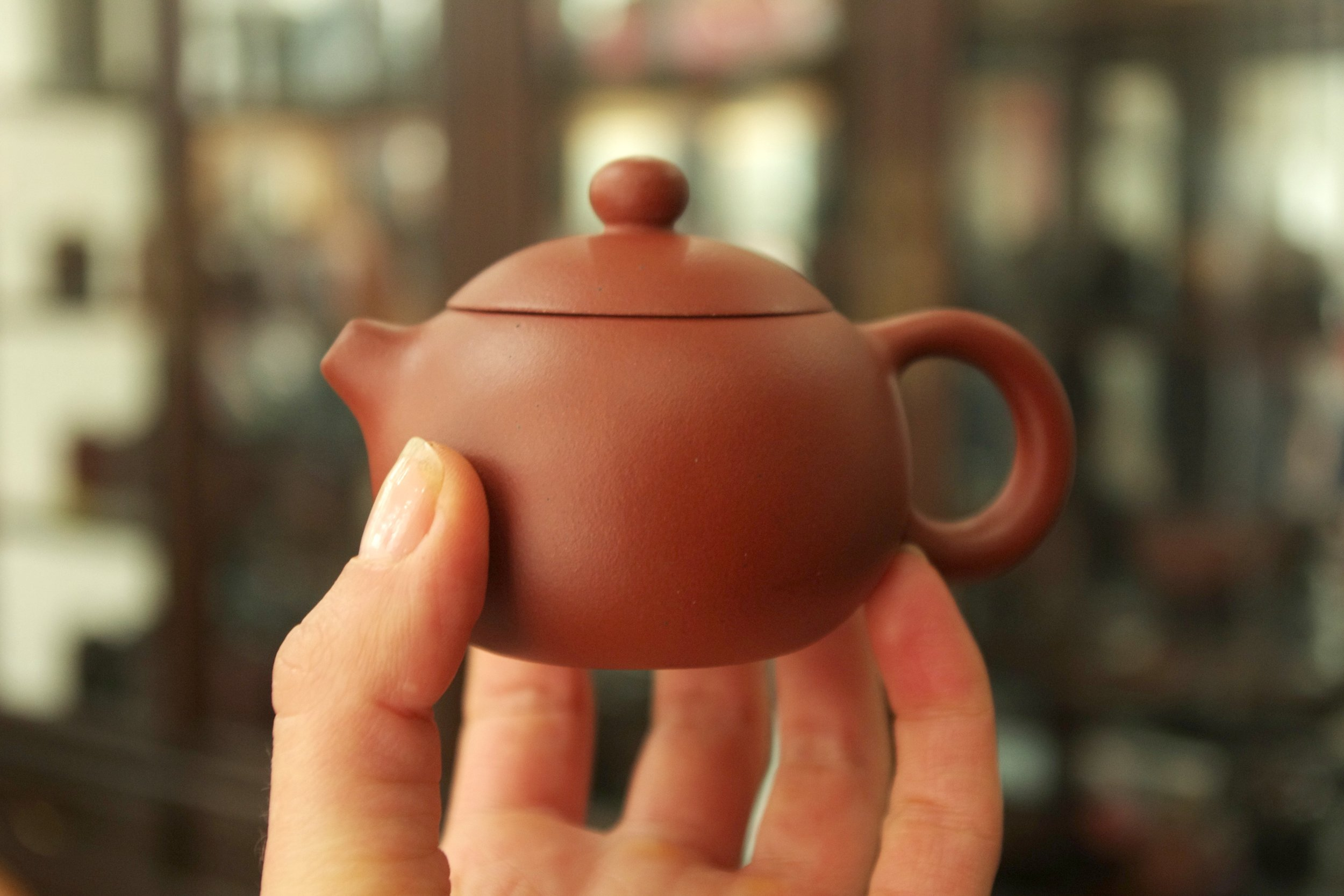 Yixing teapot in my fingers