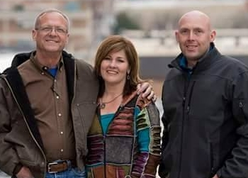 Bob and Marcy Brown stand with VP of Operations Chris Comeau at the site of another of their projects.  See this project at  www.hdleetowers.com .