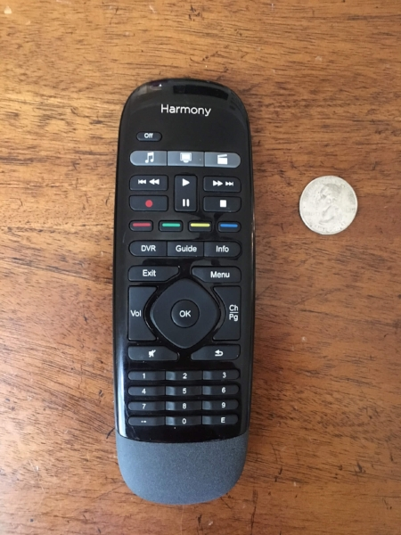 Our cute little remote next to a shiny quarter