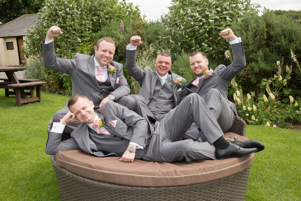 Happy groom and ushers at The South Causey Inn