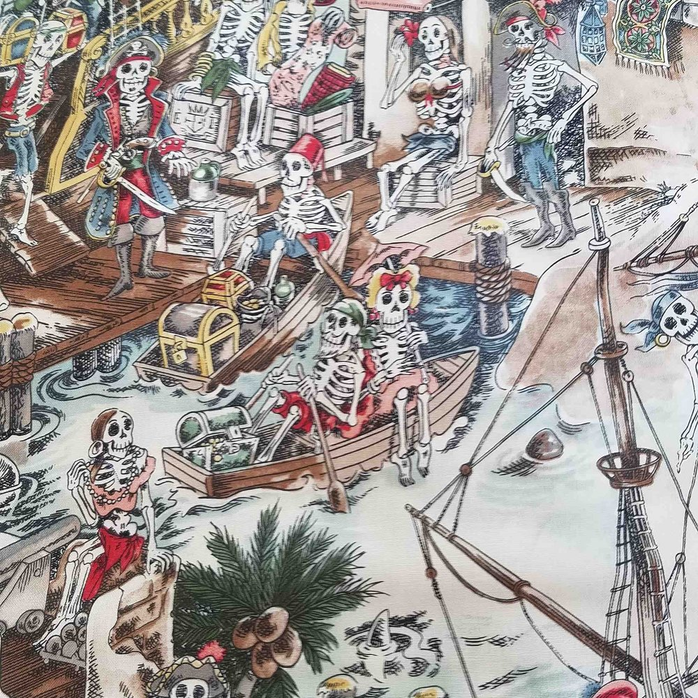 SKELEWAGS FABRIC   This 100% Cotton Lawn print of fanciful Pirate Skeletons nearly reads like a tale of adventure at sea. Sword fights, rescued maidens, mermaids, it's all happening on this fun fabric. The soft watercolor print on a neutral background suits shirts and dresses perfectly.   Come aboard maty!