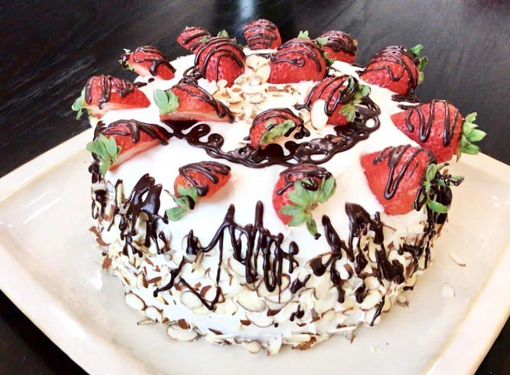 You can decorate your cake with the any berries, nuts, or type of chocolate. I try to decorate with the berries I am using inside the cake. That allows the flavor to stay consistent.  A tip to melt the chocolate is use a double browler or melt in the microwave with a few teaspoons of heavy whipping cream.
