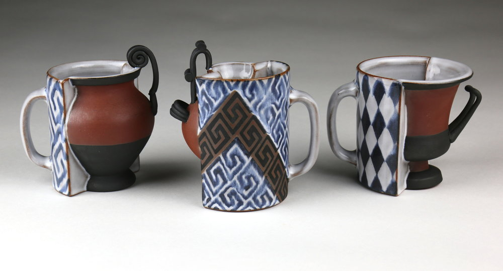 "Blair Clemo ,  Everyday Objects: Mugs , 2016                Red stoneware,  5.5. x 5 x 4"", 5.5"" x 5"" x 4"", 4.75"" x 5"" x 4"" Image courtesy of the artist"