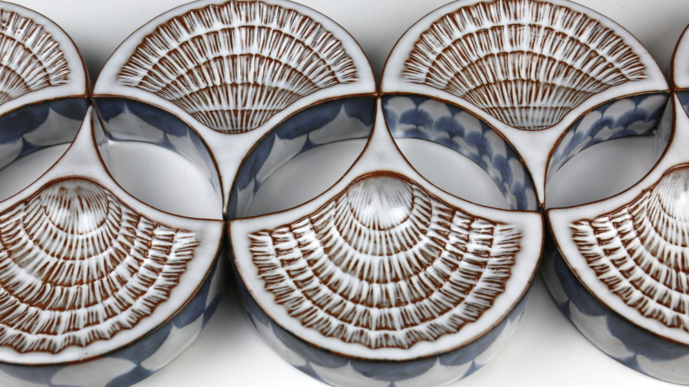 "Blair Clemo ,  Tesselating Epergne Dishes  (detail), 2016                        Red stoneware, 1.5"" x 6"" x 6"" (each) Image courtesy of the artist"