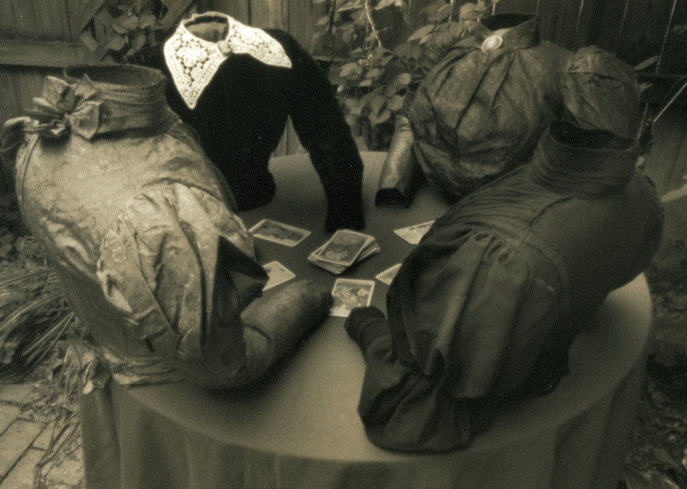 """Willie Anne Wright, """"Caroline, Kate, and Friends Consult the Tarot,"""" from Tableaux, 2001. Sepia toned silver print from a pinhole negative. Image courtesy of the artist and Candela Gallery, Richmond."""