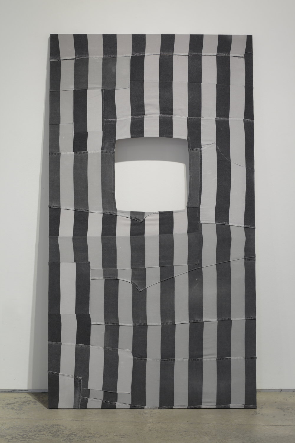 Hank Willis Thomas,   Every Act is Political…(Buren) , 2016  quilt made out of decommissioned prison uniforms  image courtesy of The Visual Arts Center of Richmond