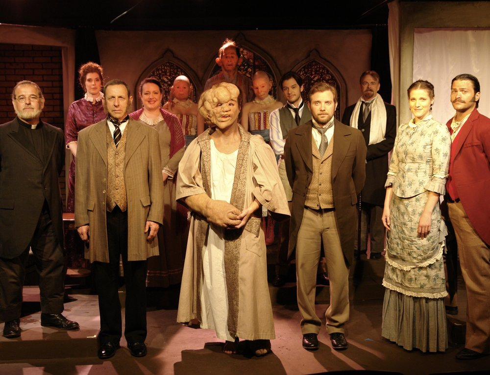 Company of Lascaux Entertainment's 2011 production of  The Elephant Man , directed by John Drouillard:  (L-R)  Trent Hopkins, Devri Richmond, Sal Viscuso, Stephanie Roche, Lyndsey Hogan, Sean Hoagland, Nick Cimiluca, Margarita Maliagros, Caleb Neet, Alex Monti Fox, Bill Durham, Hilary Herbert, and David Folsom.  Photo by John Drouillard.