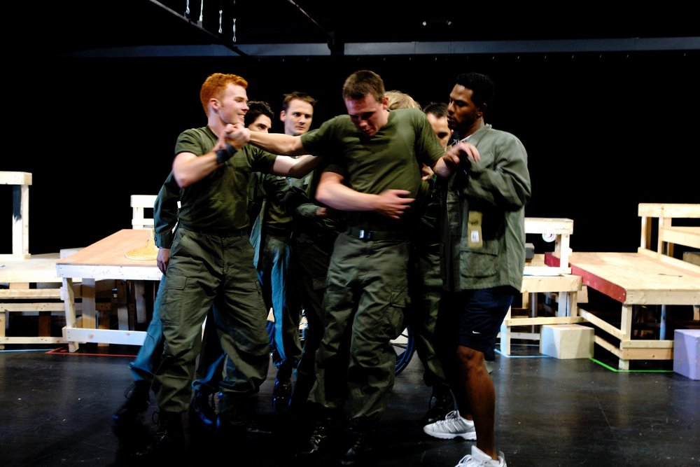 Actors Matthew Koehler, Julian Colletta, Travis Hammer, Sean Hoagland, Nick Cimiluca, Michael Yavnieli, Jeremy Ordaz, and Sean Ryal rehearse the opening sequence of James A. Blackman, III & Hermosa Beach Playhouse's 2008 production of  Tracers , directed by John Drouillard.  Photo by Natalie Drouillard.