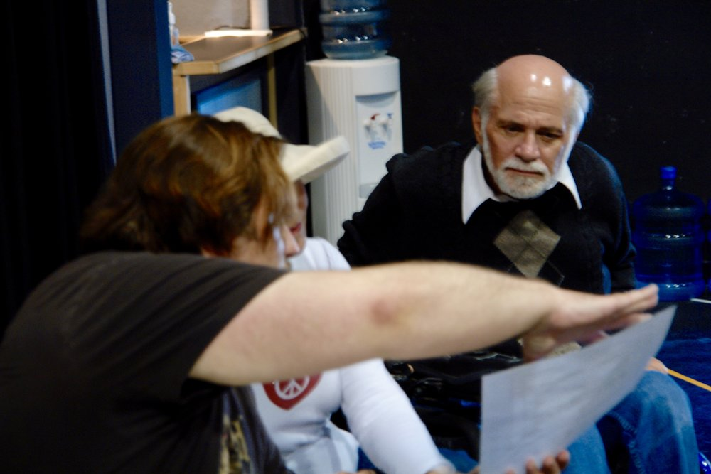 Director John Drouillard discusses a scene with TerriAnn Ferren and author Ron Kovic ( Born on the Fourth of July ) during a rehearsal for James A. Blackman, III & Hermosa Beach Playhouse's 2008 production of  Tracers , directed by Drouillard.  Photo by Natalie Drouillard.