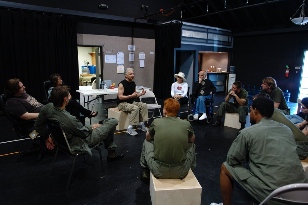 Tracers  creator John DiFusco, visiting a rehearsal with author Ron Kovic ( Born on the Fourth of July ), discusses the show with the cast of James A. Blackman, III & Hermosa Beach Playhouse's 2008 production of  Tracers , directed by John Drouillard.  Photo by Natalie Drouillard.