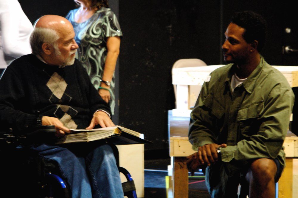 Author Ron Kovic ( Born on the Fourth of July ) talks with actor Sean Ryal during a rehearsal for James A. Blackman, III & Hermosa Beach Playhouse's 2008 production of  Tracers , directed by John Drouillard.  Photo by Natalie Drouillard.