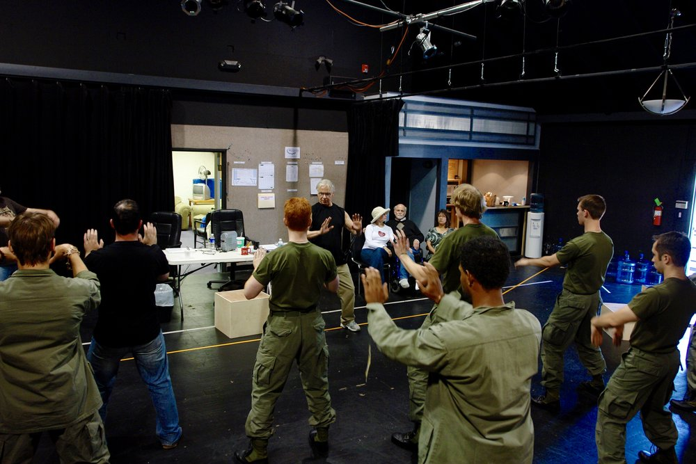 "Tracers  creator John DiFusco, visiting with author Ron Kovic ( Born on the Fourth of July ), teaches ""The Ghost Dance"" to the cast of James A. Blackman, III & Hermosa Beach Playhouse's 2008 production of  Tracers , directed by John Drouillard.  Photo by Natalie Drouillard."