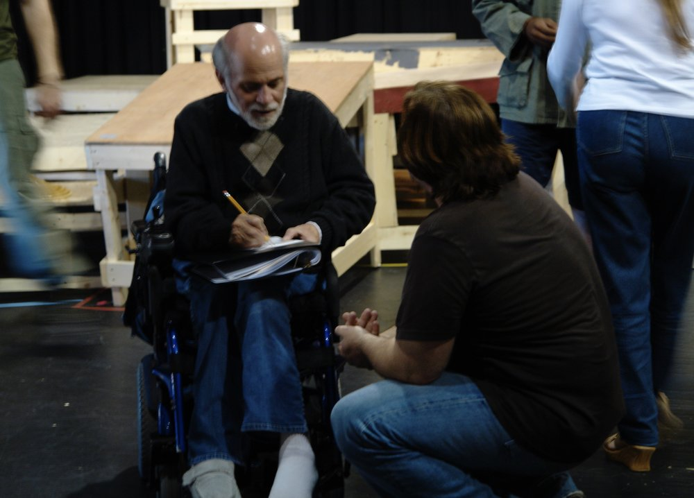 Author Ron Kovic ( Born on the Fourth of July ) talks with director John Drouillard in the rehearsal room of James A. Blackman, III & Hermosa Beach Playhouse's 2008 production of  Tracers , directed by Drouillard.  Photo by Natalie Drouillard.