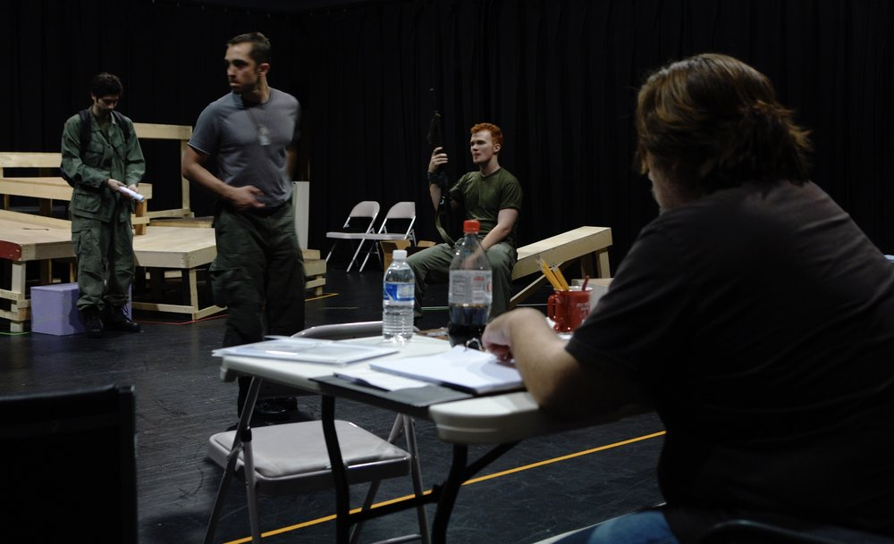 Actors Julian Colletta, Jeremy Ordaz, Matthew Koehler, and director John Drouillard work on a scene in rehearsal for James A. Blackman, III & Hermosa Beach Playhouse's 2008 production of  Tracers .  Photo by Natalie Drouillard.