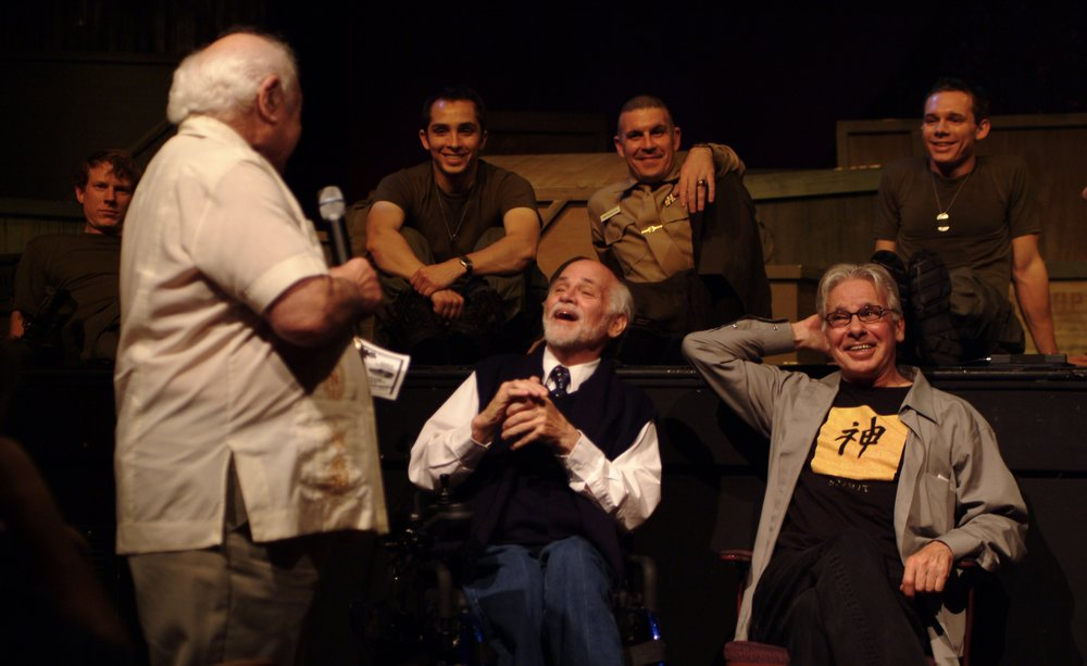 A fellow veteran shares a moment with author Ron Kovic ( Born on the Fourth of July ) and  Tracers  creator John DiFusco Author Ron Kovic ( Born on the Fourth of July ) during the opening night post-show panel discussion for James A. Blackman, III & Hermosa Beach Playhouse's 2008 production of  Tracers , directed by John Drouillard.  Photo by Alysa Brennan.