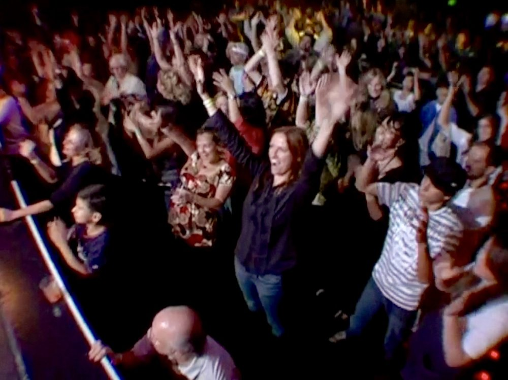 Excited audience members at GLAD & Sprint Relay's 2007 concert  Beethoven's Nightmare Live At The El Rey , produced by Bob Hiltermann, John Drouillard, and Natalie Drouillard.  Still from Wordplay, Inc.'s 2010 feature documentary,  See What I'm Saying , cinematography by Jeff Gatesman, directed by Hilari Scarl.