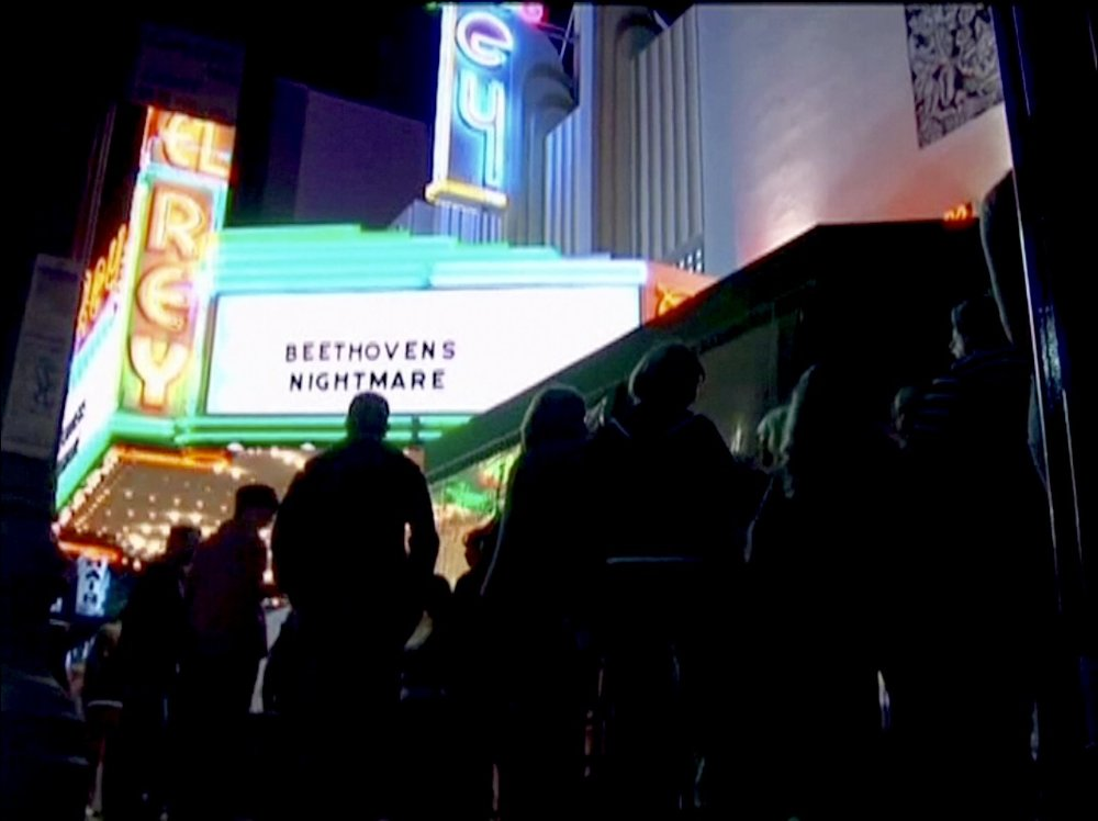 The scene outside the El Rey before GLAD & Sprint Relay's 2007 concert  Beethoven's Nightmare Live At The El Rey , produced by Bob Hiltermann, John Drouillard, and Natalie Drouillard.  Still from Wordplay, Inc.'s 2010 feature documentary,  See What I'm Saying , cinematography by Jeff Gatesman, directed by Hilari Scarl.