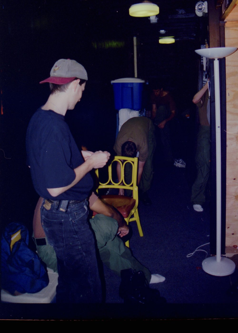 Stage manager Chris Beyries assesses the situation backstage closing night of Draw the Sneck Productions' 1997 production of  Tracers , directed by John Drouillard.  Photo by John Drouillard.
