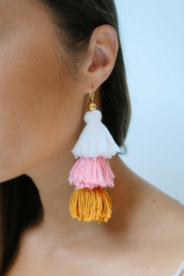 DIY Tassel Earrings   Yeah! We want tassel everything!  via  apairandasparediy