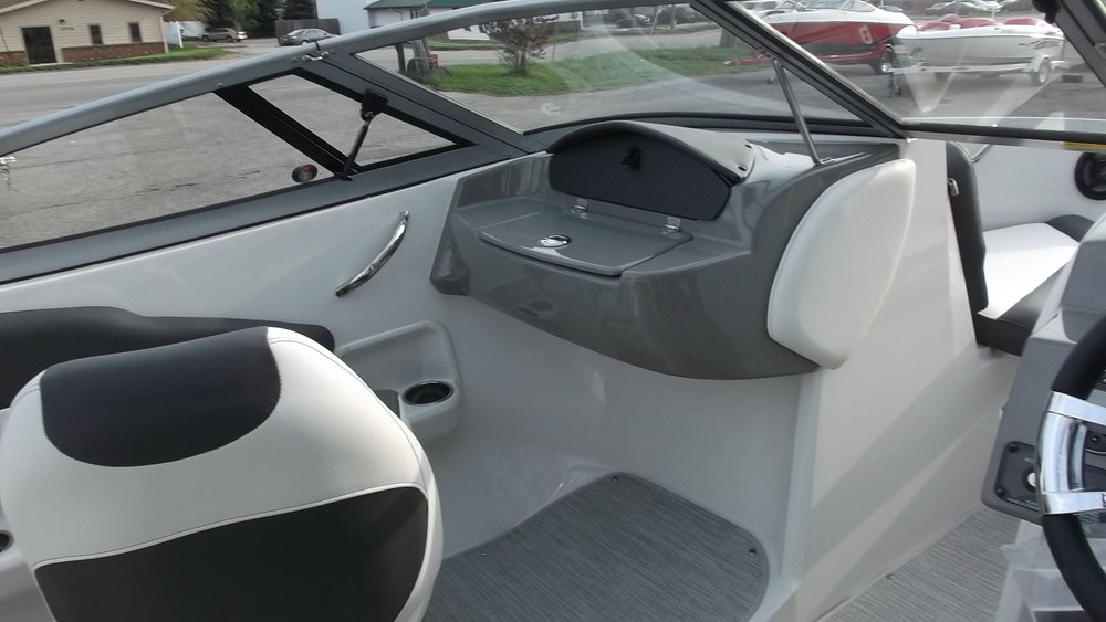 Passenger cupholders, Stainless steel grab rails, and dual glove box storage compartments