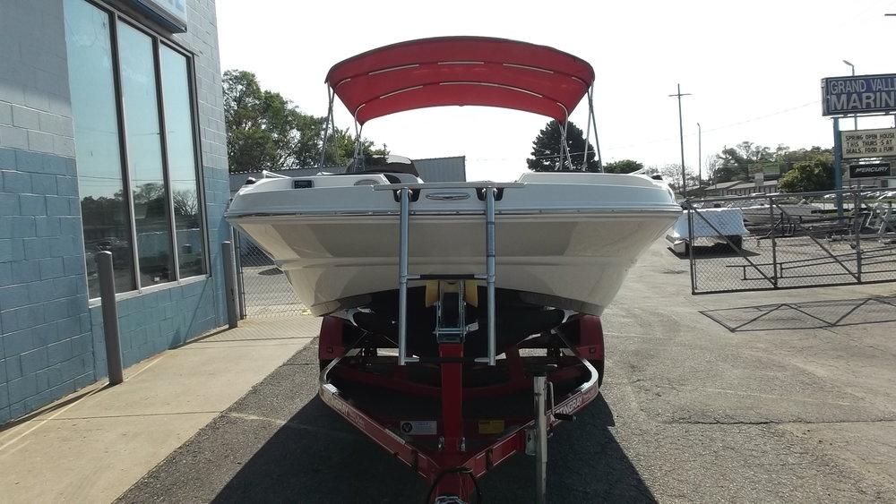 Bow boarding ladder, dedicated pop cleat for anchoring, bow stereo remote, swing tongue on trailer...
