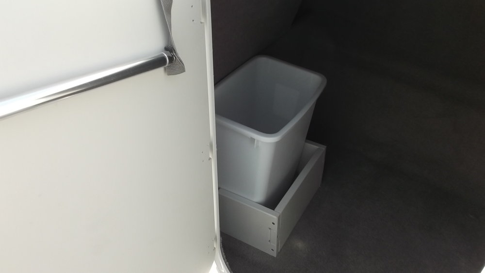 Huge starboard side console storage w/waste basket and paper towel holder