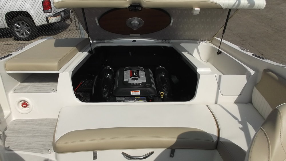 Removable walk-through cushion, gas lift assisted engine hatch/sun-pad, and plenty of storage