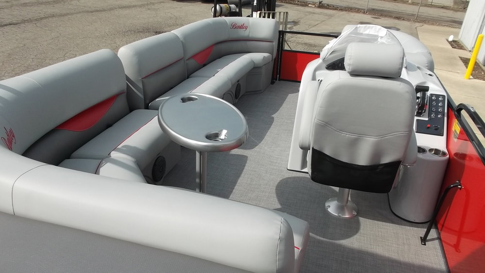 Removable gate couch on the port side also fits in the bow to make wrap around seating. Removable table, SeaGrass Floor, high back captain's chair...