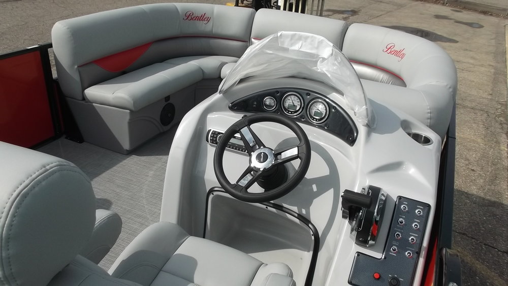 Fiberglass console with tilt/hydraulic steering