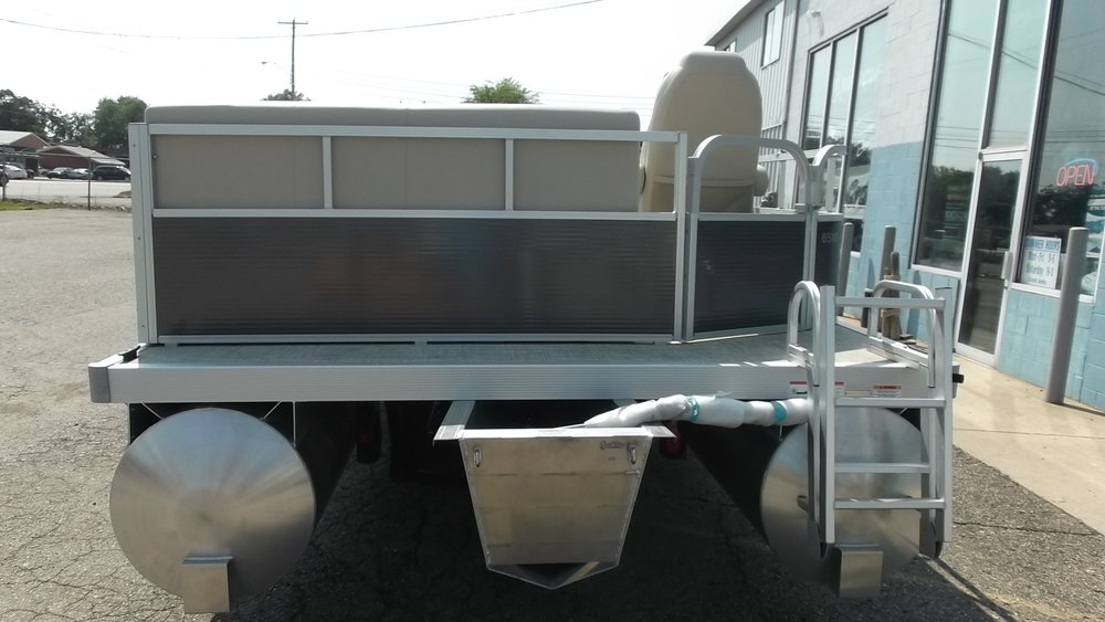Stern entry with collapsible boarding ladder. A Mercury 40hp 4 stroke is included