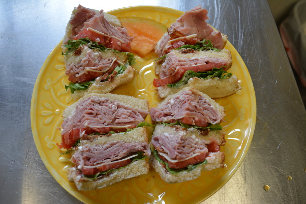 Hunter's Triple Decker Club - Thin sliced HAM piled high, with bacon, tomato, lettuce, American cheese and mayonnaise