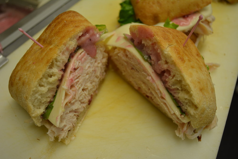 Turkey and Provolone - Sliced Turkey, Provolone cheese and a piece of lettuce, topped with our homemade cranberry mayonnaise
