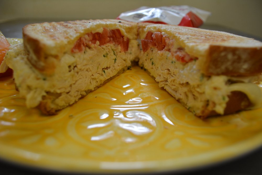 Chicken Salad    MELT - Homemade chicken salad topped with tomato and American cheese, on a panini.