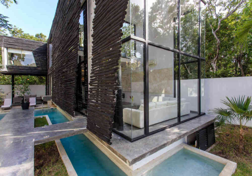1_tulum_vacation_rentals_casa_crystal_pool_and_windows.jpg
