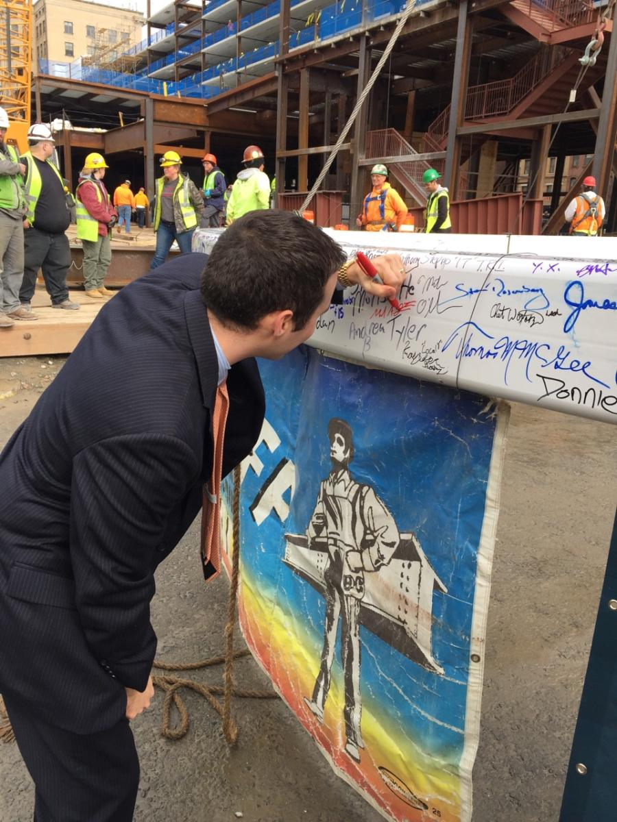 Mike signing the final beam to the MGM hotel.