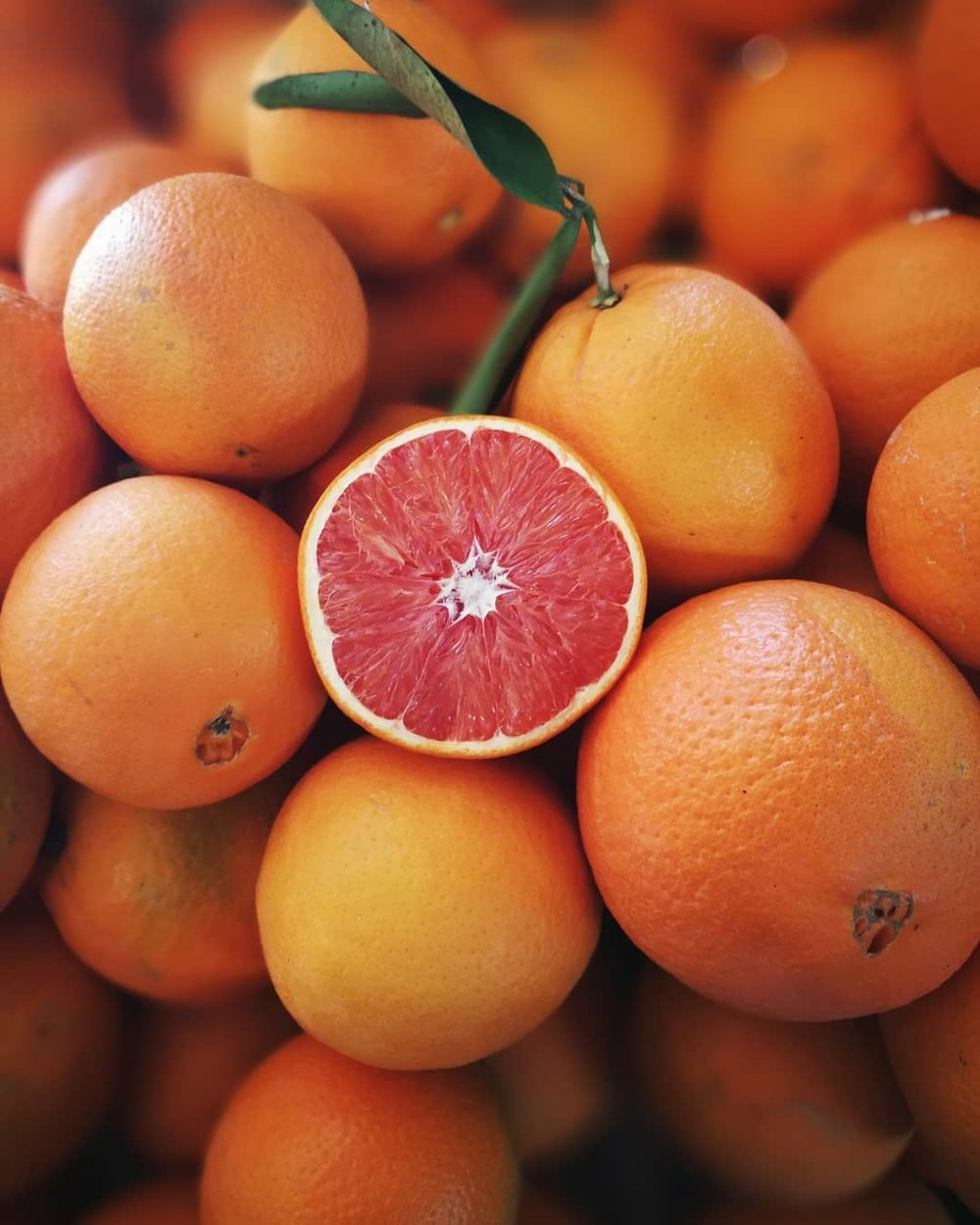 CARA-CARA Navel Oranges - Cara-Cara Navels are thought to be a cross/mutation of the Washington Navel . The Cara has red flesh similar to that of a Ruby-Red Grapefruit. Often confused as a blood orange, they are considered a specialty orange.