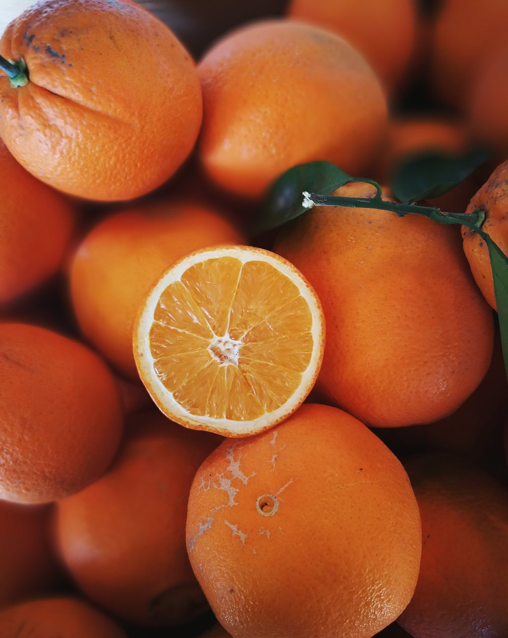 NEWHALL Navel Oranges - A newer variety of the navel orange, the Newhall is oblong with a thicker peel (makes it easier for peeling). It can also be used for juicing.