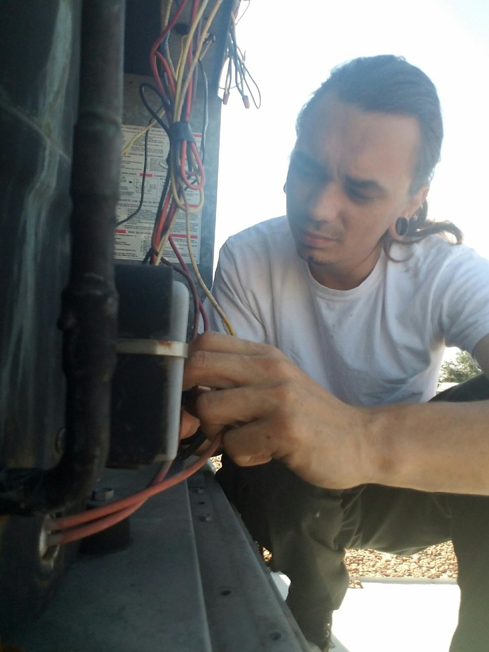 Jonathan repairing a commercial package unit