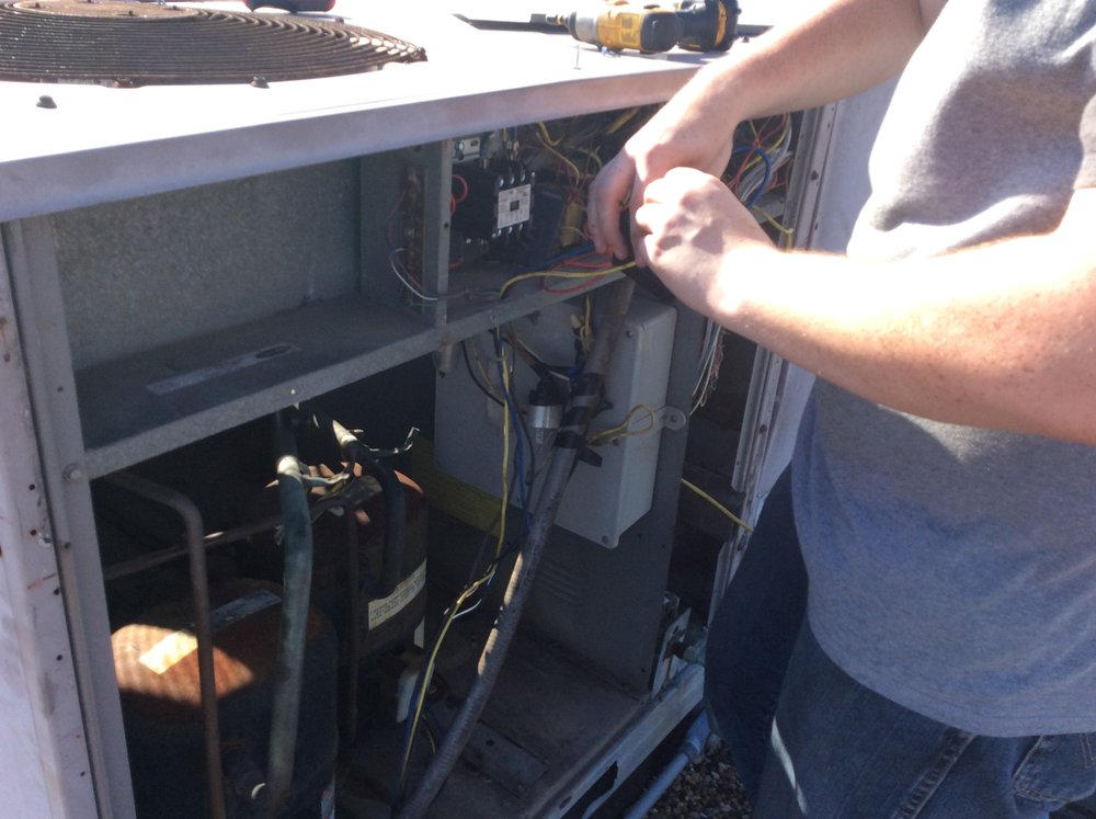 Remington our youngest tech, making repairs to a commercial unit. #hvactech #youthofthenation #millennialtechs