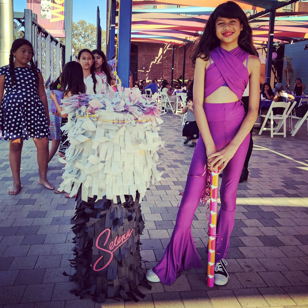 The birthday girl's mom made the Selena microphone piñata and has since decided to launch her own piñata business, Party Girl Piñatas.